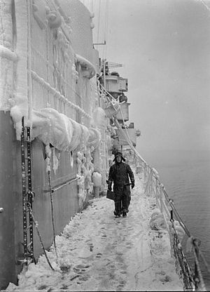 HMS Scylla (98) - A member of crew on the snow-covered deck whilst on patrol in the North Atlantic