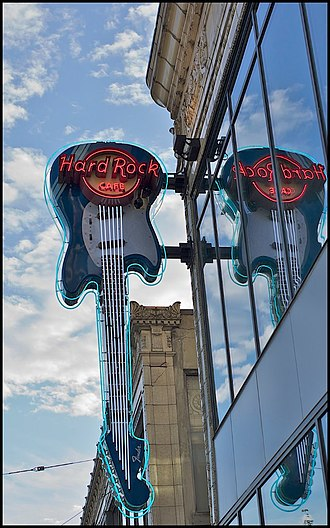 Queensrÿche (album) - The Hard Rock Cafe in Seattle, where four Queensrÿche members and La Torre first performed as Rising West, and where they were approached by their future manager.