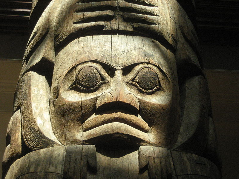a totem pole closeup in Gwaii Haanas National Park in Northern British Columbia