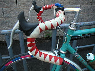 Bicycle handlebar - Conventional drop handlebars with harlequin cloth tape wrapping.