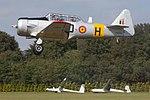 Harvard H-210 doing a low pass in Hilversum (10759308993).jpg