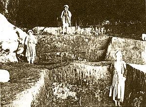 Hazar Merd Cave - Hazar Merd 1928, three Kurdish boys standing on different levels of excavation trenches