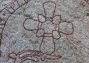 Gamla Turingevägen Inscriptions - Detail showing cross and serpent head on Sö 312.