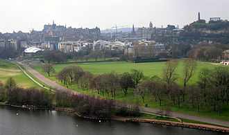 Holyrood, Edinburgh - Taken from Holyrood Park in 2004. From left to right: Our Dynamic Earth, Edinburgh Castle, Scottish Parliament Building, Palace of Holyroodhouse, Scott Monument, Balmoral Hotel clock tower and Nelson's Monument.