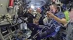 ISS-56 Ricky Arnold, Oleg Artemyev and Drew Feustel train in the Zvezda.jpg