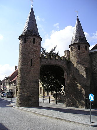 Lo-Reninge - The 13th century city wall of Lo, with the Caesar's Tree behind it.