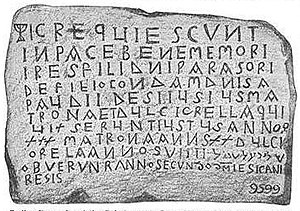 Jewish Encyclopedia - Illustration of Jewish grave in France with menorah used for the h in hic and Hebrew characters at the bottom right.
