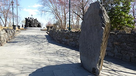 """Leacht Cuimhneachain na Gael"", an Irish famine memorial at Penn's Landing honors the large Irish community (14.2% of the city's population). Irish Memorial in Philadelphia 1.jpg"