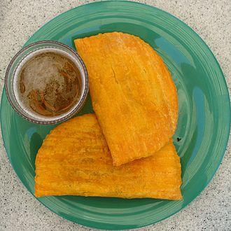 Jamaican cuisine - Jamaican patties and Red Stripe beer