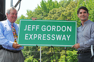 Interstate 85 in North Carolina - Secretary of the North Carolina Department of Transportation Gene Conti and NASCAR driver Jeff Gordon unveiling a sign for the Jeff Gordon Expressway