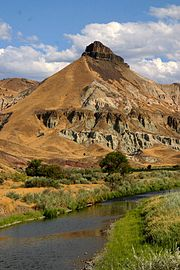 The John Day River passing by Sheep Rock in the John Day Fossil Beds National Monument