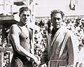 Johnny Weismuller and Duke Kahanamoku shaking hands.jpg