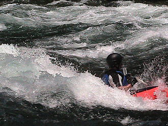 "Watauga River - Kayaker at the Bee Cliff Rapids paddling inside ""The Big Hole"""