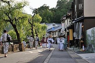 Kinosaki, Hyōgo - People dressed in yukata, walking along the streets of Kinosaki.