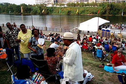 Kirk Whalum visiting the audience at a riverfront concert in 2007 Kirk Whalum, music festival in Nashville.jpg