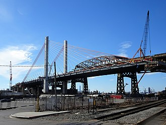 Kosciuszko Bridge (New York City) - New and old Kosciuszko bridges in February 2017. New cable-stayed bridge is in foreground left. The 1939 truss bridge is behind it and right.