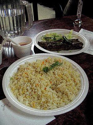 Lahori cuisine - Plain rice and Lahori lamb kebab.