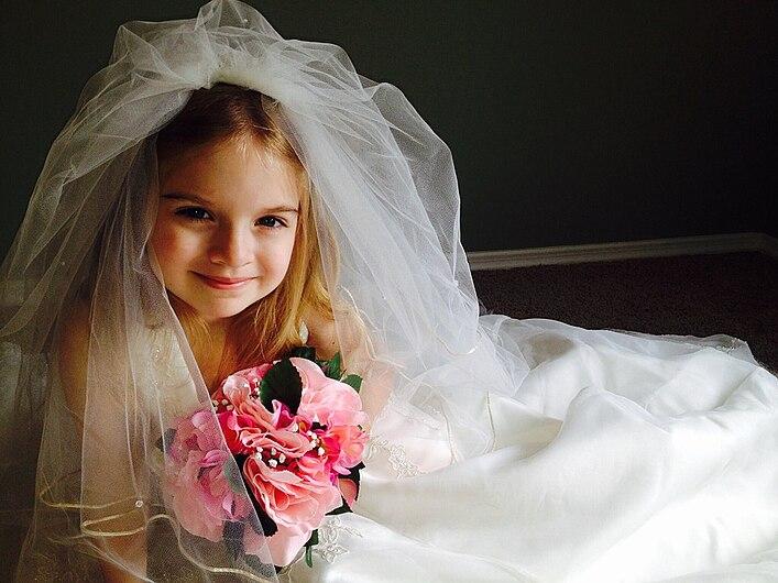 Little girl wearing a white wedding dress 1.jpg