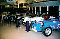 Lotus Sevens and Six plus a Caterham (636899022).jpg