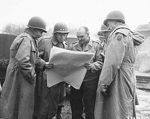 Manton S. Eddy - Lieutenant General Omar Bradley, Lieutenant General George S. Patton, and Major General Manton S. Eddy being shown a map by Major General John S. Wood during a tour near Metz, France, November 13, 1944.