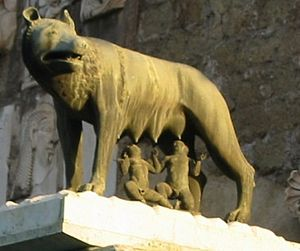 Self-fulfilling prophecy - Romulus and Remus feeding from a wolf.