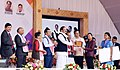 M. Venkaiah Naidu giving away Certificates and Grants to Students after launching Deen Dayal Divyangjan Sahajya Achoni, on the occasion of International Day of Persons with Disabilities, in Guwahati, Assam.jpg