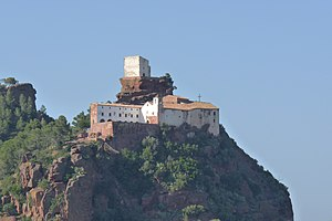 Mont-roig del Camp - The sanctuary of Our Lady of the Rock with the chapel of  Sant Ramon above