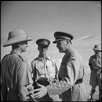 24th Battalion (New Zealand) - Major General Bernard Freyberg (centre right), arriving to conduct a review of 6th Brigade, is greeted by the commander of 24th Battalion, Lieutenant Colonel Clayden Shuttleworth (left), and Brigadier Harold Barrowclough, September 1941