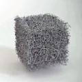 Malla de fibras de vidrio de un filtro HEPA aumetanda.png