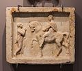 Marble plaque Romans discussing archmus Heraklion.jpg