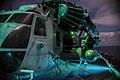 Marines conduct maintenance on an SH-53E Super Stallion on the flight deck of USS Bonhomme Richard. (29777249646).jpg