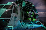Marines conduct maintenance on an SH-53E Super Stallion on the flight deck of USS Bonhomme Richard. (29777249646).jpg