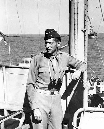 Lieutenant General Mark Clark on board USS Ancon during the landings at Salerno, Italy, 12 September 1943. Mark w clark 1943.jpg