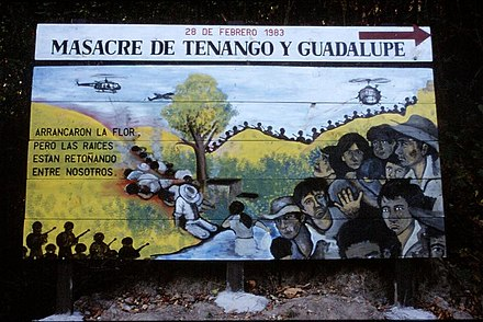 A billboard serving as a reminder of one of many massacres that occurred during the civil war. Masakro-ce-Suchitoto-Salvadoro.jpg