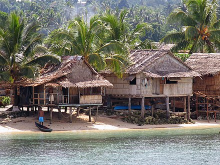 Malaita island Medium shot of idyllic villages beach near Auki, the capital of Malaita. (10702263414).jpg