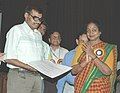 Meira Kumar presented a cheque of Rs.50,000 and felicitation letter to Shri Kuldeep Singh, DTC bus driver at the inauguration of an interactive Disability Helpline, in New Delhi on April 20, 2006.jpg