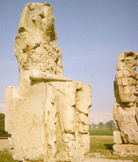 18 m (59 ft) high sandstone statues of Amenhotep III, flanking the entrance to his mortuary temple in Western Thebes - erroneously identified as the Colossi of Memnon by Greek travellers in antiquity