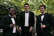 Three men in black tie variants.
