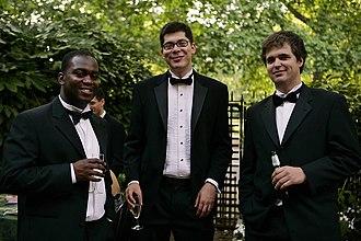 History of suits - Three men in 2006 wearing black tie variations.