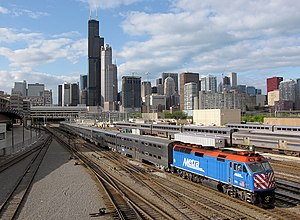 A Metra train in downtown Chicago bound for th...