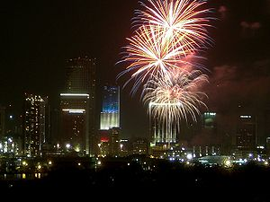 Color scheme - Celebration with fireworks over Miami, Florida, USA on American Independence Day.  Bank of America Tower is also lit with the red, white and blue color scheme.