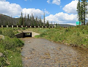 Interbasin transfer - Michigan Ditch in northern Colorado carries water from the North Platte River watershed over Cameron Pass to the South Platte River watershed.