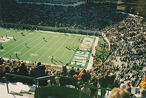 2001 Michigan vs. Michigan State football game - The Wolverines taking the field for pre-game warm ups.
