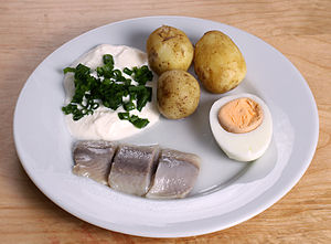 Traditional pickled herring with sourcream and...