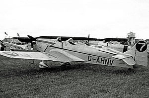 Pendeford - Aircraft at Pendeford Airfield in 1950 showing the black Bellman-type wartime hangars and the airfield control tower (right).
