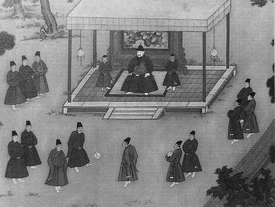 The Yongle Emperor observing court eunuchs playing cuju, an ancient Chinese game similar to soccer. Ming-Emperor3.jpg
