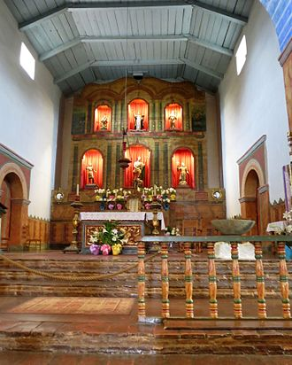 Mission San Juan Bautista - The church chancel with Easter decoration