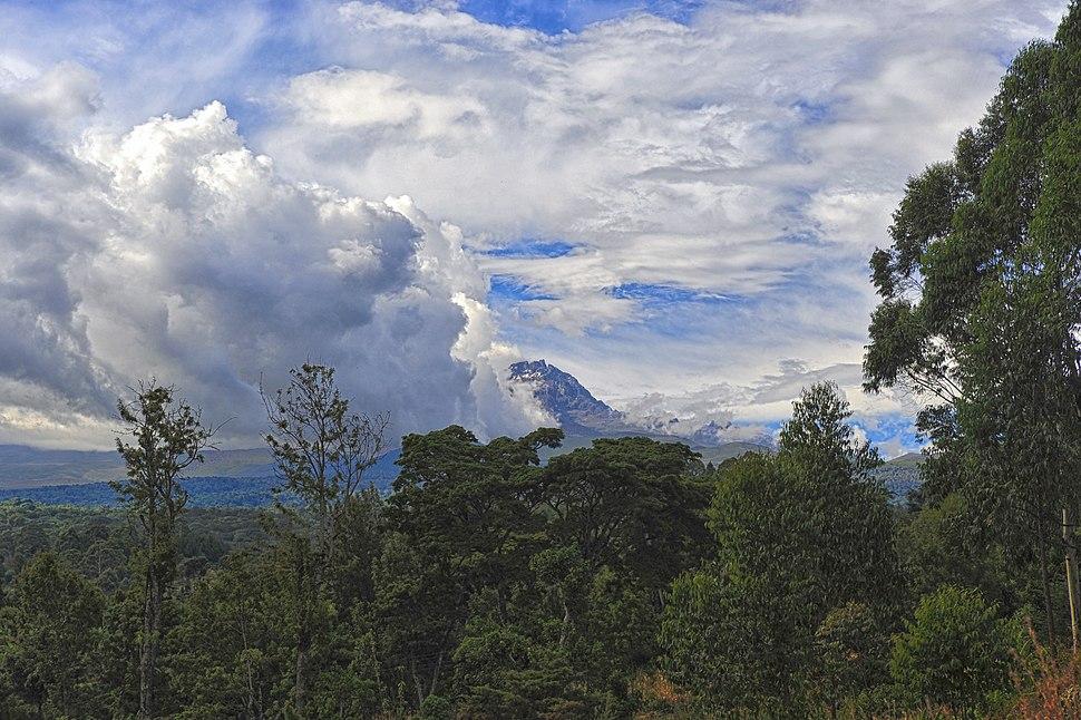 Mount Kilimanjaro peeking through the clouds