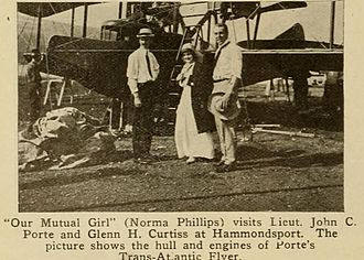 John Cyril Porte - A cutting from Moving Picture World 25 July 1914: Glen Curtiss, actress Norma Phillips (Our Mutual Girl) and Porte with his characteristic straw hat in front of the Trans-Atlantic Flyer.