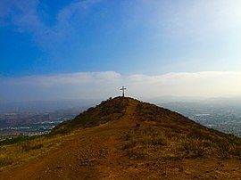 The cross on Mount McCoy with Simi Valley in distance.